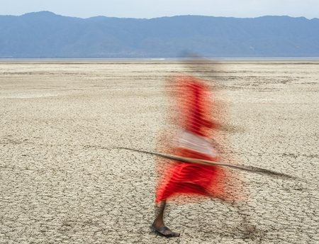 """Maasai Warrior On A Dry Lake Bed (Drying Earth - Disappearing Cultures)""     Lake Manyara, Tanzania"
